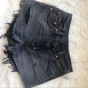 Levi's 501 distressed black denim shorts